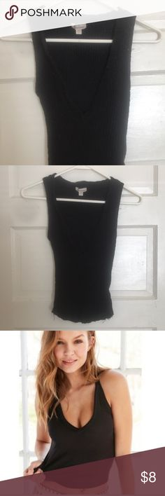 Silence and noise  v neck sweater tank Urban outfitters ribbed black sweater deep v tank top! Says extra small but fits small as well. PIC IS NOT EXACT TOP- JUST FIT. Super cute for parties and going out to dinner, v is very deep and provocative, super soft material.   MAKE ME AN OFFER   ignore tags: urban outfitters, black sweater, v neck, silence & noise, silence and noise, pacsun silence + noise Tops Tank Tops