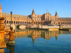 Spain Square / The Plaza de España is a plaza located in the Parque de María Luisa (Maria Luisa Park), in Seville, Spain built in 1928 for the Ibero-American Exposition of It is a landmark example of the Renaissance Revival style in Spanish architecture. Spanish Architecture, Balearic Islands, What A Wonderful World, Travel Images, Best Cities, Plaza, All Over The World, Wonders Of The World, Explore