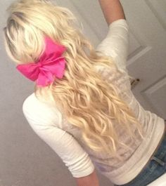 Blonde curly hair with pink bow! Easy hairstyle!