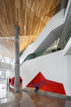 Architecture - The Maison des étudiants de l'École de technologie supérieure (ÉTS) - nspired by an icehouse that once stood on the site, the crystal-like volume is remarkably light, open and airy. The mixed-use program was unified into a singular sculpted volume, its offsets interacting in a refreshing way with the more sober and introverted campus buildings. #design #institutionnal #crystal #campus #university #Montreal #wood