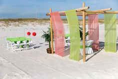Seaside Beach wedding package lime green and red with arbor, sand ceremony, palms, lime green chair sashes and red poofs. Beautiful Orange Beach and Gulf Shores Alabama Beach wedding packages. All-Inclusive, Custom, Create your own.