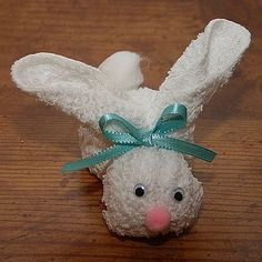 Use these step-by-step directions to craft a bunny using a wash rag and a few other supplies.