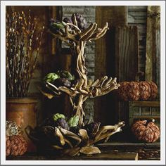 bet I could DIY one! drift wood tiered stand