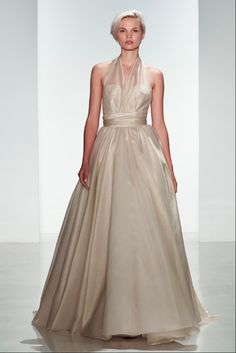 """The name Amsale (pronounced Ahm-sah'-leh) has become synonymous with the """"forever modern"""" wedding dress. Her collections are designed for brides who desire a fashionable, sophisticated and timeless look. Amsale believes: """"Twenty years after the wedding, I want a bride to be able to look at her pictures and be as happy with the way she looked as she was on her wedding day."""
