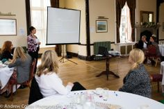 """Delegates enjoying a presentation the recent """"Women in Business"""" networking lunch."""