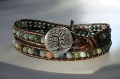 I made this bracelet using 4mm Fancy Jasper stone beads and brown leather cord. It will wrap around your wrist two times and the loop at one end will close around a silver tree of life button at the other end.