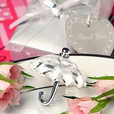 So cute...crystal umbrella favors!