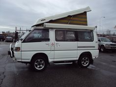 This was the camper I wanted, but we went with an 88 Westy instead!   1992 Mitsubishi Delica Camperized Automatic only 49000 km, 2.5L 4 cyl, Diesel Turbo, 4X4, pop-up roof sleep 3-4, fully equiped with winch, rear hitch, stove, fridge, awning and other camping gears-right hand drive