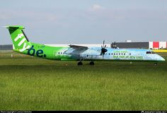 Flybe (UK) De Havilland Canada DHC-8-402Q Dash 8 G-JEDP aircraft, named ''Spirit of Belfast'', painted in ''Low cost, but no at any cost'' special colours until Jan. 2014, skating at Germany Hannover Langenhagen International Airport. 19/05/2013.