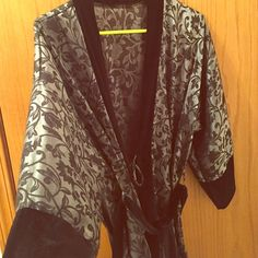 Silky Satin Robe Floral pattern black and silver/grey robe. Super comfy and soft. Bath or intimate wear. Very un-noticeable imperfection in 3rd picture. Fits small-large.  **All items hand washed/sterilized/dried before shipping. Smoke free home.** Intimates & Sleepwear Robes