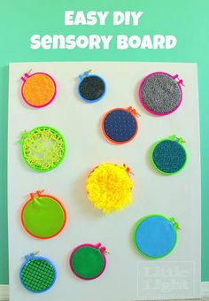 DIY Sensory Wall- a fun art and crafts idea for a kids activity.  Bright and colorful and fun!