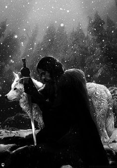 Jon Snow of game of thrones with his dire wolf