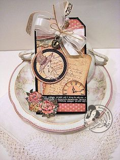 This is a beautiful A Ladies' Diary tag by @Kristin Wilson! Love all the fussy cut details and the ribbon. Gorgeous work! #graphic45 #tags