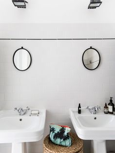 Twin basins and mirrors in the bathroom of the lovely  home of French stylist Anne-Fleur Broudehoux. Photo - Louise Desrosiers. Shared with kind permission from Milk Magazine.