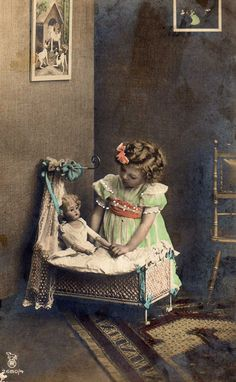 girl with doll and doll bed
