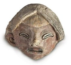 Photo published June 9, 2015 by the Ministry of Culture of Peruvian pre-Columbian mud clay figurine found in northern Peru (Photo /afp.com)