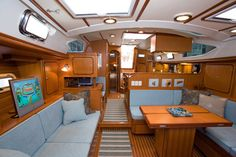 Passport Voyager 480 interior is a choice of American cherry or Burmese teak veneers and solid wood doors and lockers.  All bulkheads are of marine grade plywood tabbed to hull sides and deck. Solid wood trim on all interior bulkheads and cabinetry.  See more of her here: