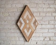 24in. W x 14in. H Handmade wood wall art with reclaimed wood pattern. We can customize sizes of this design in our shop if this one isnt just right for your space. Made to order. Size, color and texture will have small variations due to the nature of reclaimed wood. Made with raw
