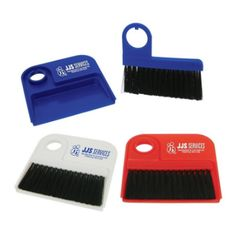 """The dust tray and brush is great household product for cleaning up any mess. This mini dust pan set is ideal for quick pickup especially when you're on the go! Makes a great desk item!  4 3/4"""" W x 4 5/8"""" H Colors: Red/Black, White/Black, Blue/Black"""