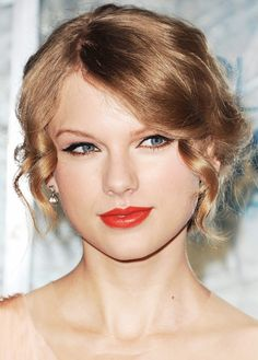 Here, Swift sets off the pinkish tones of this red lipstick with a smudge of copper liner along her lower lash line. Makeup artist Lorrie Turk also used CoverGirl Lip Perfection Liner ($7) in...