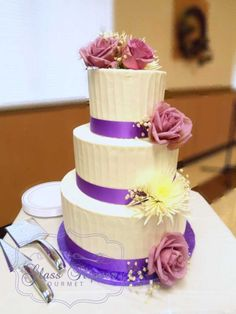 textured buttercream with purple ribbons wedding cake