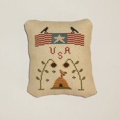 Completed Cross Stitch Primitive Patriotic Tuck by arcadecache