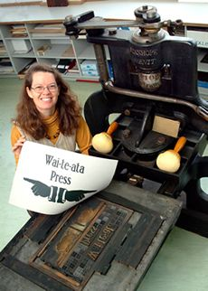 Dr Sydney Shep with an 1813 Stanhope Press, the oldest printing press in New Zealand and still in use