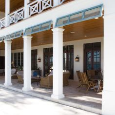 Dreamy two story porch, it's the dark/white contrast that makes it so british west indies style