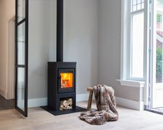 Freestanding modern wood-burning stove made to measure Flores 8 by Buntfires . - Freestanding modern wood burner custom made Flores 8 from Buntfires # wood stove - Home Fireplace, Wood Heater, Home And Living, Home Living Room, Interior, New Homes, House Interior, Freestanding Fireplace, Home Deco