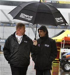 #24 Jeff Gordon outside in the rain under the Umbrella
