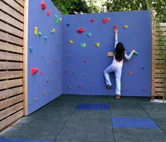 Create a Play Area Higher, sturdier garden fences are perfect for incorporating climbing walls – a soft paving area can be created by using slabs made from recycled tyres.
