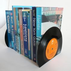 Stunningly simple and practical bookends made from two vintage 7 singles. from Folksy seller