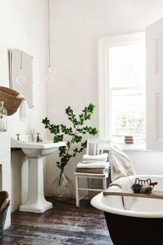 How to transform your bathroom into the ultimate home spa getaway. 8 home spa ideas to cleverly add luxury to your bathroom space with plants, bucolic elements and vibrantly patterned wall ideas. For more bathroom decor ideas go to Domino. Home Interior, Bathroom Interior, Interior Decorating, Interior Design, White Bathroom, Simple Bathroom, Vanity Bathroom, Master Bathroom, Parisian Bathroom