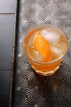 Maple Rye Sour 2 oz. rye whiskey, preferably Rittenhouse ½ oz. fresh lemon juice ½ oz. fresh orange juice ¼ oz. maple syrup ¼ oz. Luxardo Amaro Abano liqueur Strip of orange peel, for garnish
