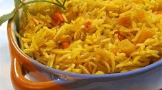 Golden basmati rice studded with dried apricots and slivered almonds gets an exotic flavor from saffron and rose water in this company-worthy pilaf.