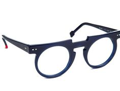 We carry a wide range of designer eyeglass and sunglass frames from Lafont, Theo, Anne et Valentin and more. Stop into our Chicago eyewear shop today. Funky Glasses, Cool Glasses, Mens Glasses, Luxury Sunglasses, Sunglasses Sale, Eyewear Shop, Optical Eyewear, Fashion Eye Glasses, Wearing Glasses