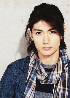 The plaid scarf. The hair cut. I like him. :)