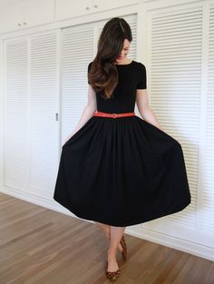 Black dress with colorful belt.