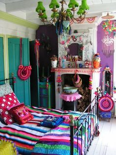 My Bohemian Home ~ Bedrooms and Guest Rooms Loving the color and whimsy of this bedroom. So many fun things to look at. Would be a great gue...