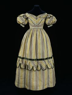 Dress        Place of origin:        Great Britain, United Kingdom (made)      Date:        1827-1829 (made)      ca. 1770 -1780 (weaving)      Artist/Maker:        Unknown (production)      Materials and Techniques:        Woven silk tobine, trimmed with silk satin, lined with cotton      Credit Line:        Given by Miss C. Grainger-Evans      Museum number:        T.1-1967      Gallery location:        In Storage