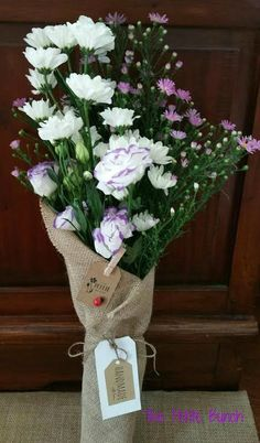 Todays Bunch combines beautiful Purple and White lissies, White Glasshouse Chrissies and Purple easter daisies.