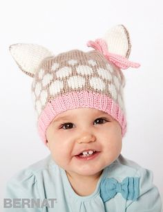 An adorable little fawn-like hat knit in Bernat Softee Baby yarns. Pink accents are perfect for girls, easily adaptable for little boys with blue.