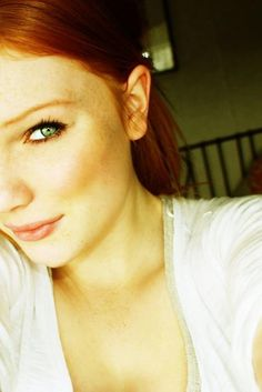 Red-haired girl with green eyes.