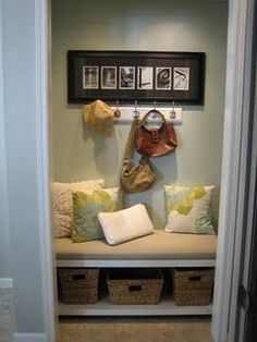 Small hall closet turned into mini mudroom!    I'm loving the whole turn a closet into a sitting area!!!