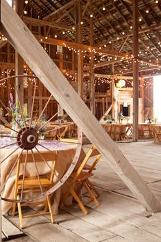rustic reception space in a barn with twinkly white lights
