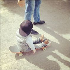 babies in snap backs on skateboards