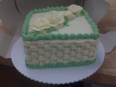 Basket weave pattern I learned at the Pacific Institute of Culinary Arts cake decorating classes. True buttercream icing using egg whites, sugar and butter of course!