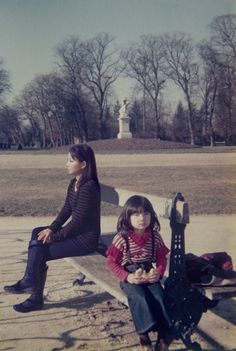 """Imagine Finding Me"" by Chino Otsuka is a series in which the photographer has taken photos of herself in the same location as some childhood pictures and then put herself into those older pics with photo-editing software. The result is an interesting blend between the past and present. This particular example shows Otsuka in the Jardin de Luxembourg, France, both in 1979 and 2009."