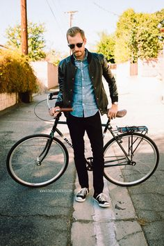 October 18, 2013.  Went for a bike ride in my new varsity jacket. Jacket: Stay Chic Fashion (c/o)Shirt: Indigo Japanese Chambray - J. Crew - $88Jeans: H&M - $29 (similar)Shoes: Converse Jack Purcell LP II - Nordstrom - $59Sunglasses: Ray Ban Clubmaster in black - $89Belt: J. Crew Factory - $22Watch: Timex Easy Reader - Target - $29