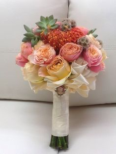 Pretty Garden Roses in Coral and Blush Bridal Bouquet by Tustin Florist